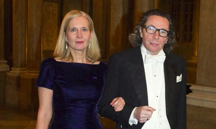 A picture taken on Dec. 11, 2011 shows Katarina Frostenson and her husband Jean-Claude Arnault arriving for the Kings Nobel dinner at the Royal Palace in Stockholm. (Henrik Montgomery/AFP/Getty Images)