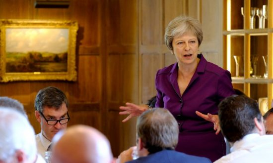 May Secures Support From UK Government on 'Soft Brexit' Plan