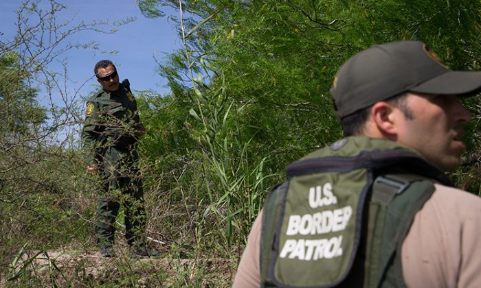 Border Patrol agents search the Rio Grande River for illegal immigrants crossing the border from Mexico into the United States on Monday, March 26, 2018 near McAllen, Texas. (Loren Elliott/AFP/Getty Images)