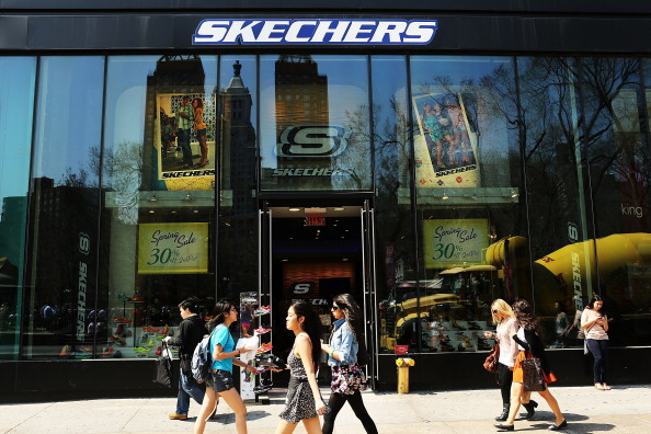 People walk by a Skechers store on April 10, 2013, in New York City.(Spencer Platt/Getty Images)
