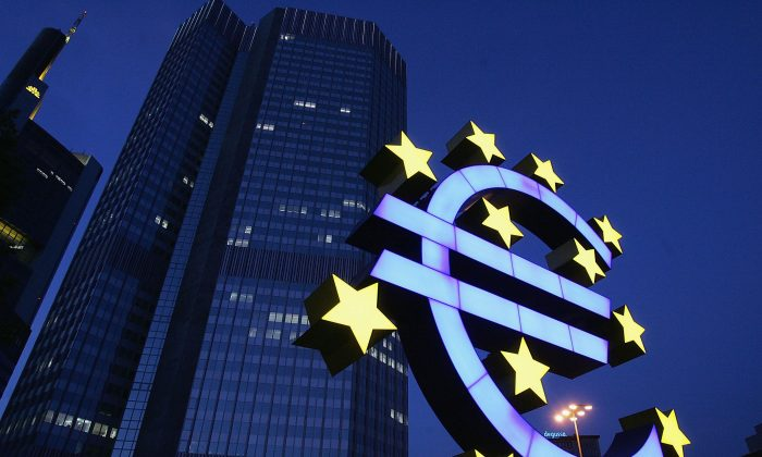 A euro logo in front of the headquarters of the European Central Bank in Frankfurt, Germany in this file photo. (Ralph Orlowski/Getty Images)