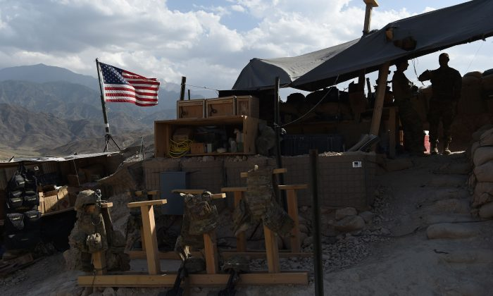U.S. Army soldiers from NATO look on as U.S. flag flies at a checkpoint during a patrol against Islamic State militants in the Deh Bala District in eastern Nangarhar Province on July 7, 2018. (Wakil Kohsar/AFP/Getty Images)