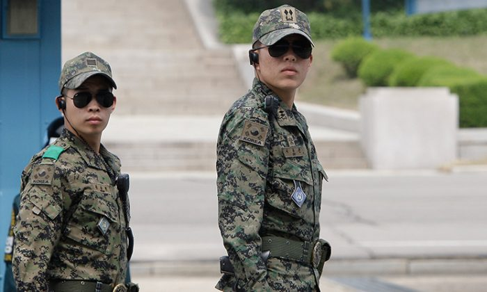 Two South Korean soldiers, unrelated to the reported case, stand guard at a border village of South Korea on May 13, 2012. (Chung Sung-Jun/Getty Images)