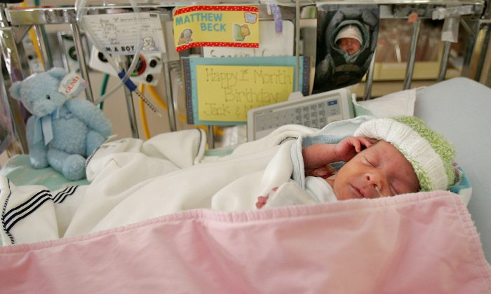 Premature baby Matthew Hirsh, born at 28 weeks, lies in the neonatal intensive care unit during a media tour for the March of Dimes' Prematurity Awareness Month at New York University Medical Center Nov. 10, 2004 in New York City. Because the United States, unlike other countries, includes premature babies in its calculation of infant mortality, statistics give a misleading picture of the nation's health care. (Mario Tama/Getty Images)