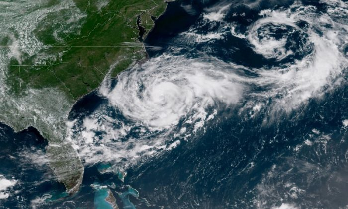 Tropical Storm Chris is shown off the eastern coast of North and South Carolina, U.S., in this satellite image July 9, 2018 at 16:12 UTC.  (NOAA/Goes-East Imagery/Handout via REUTERS)