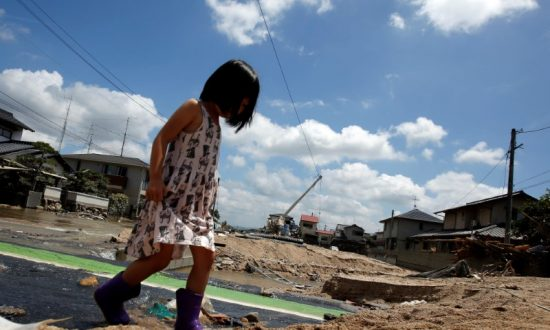 Japan Struggles to Deliver Relief to Victims of Worst Flood in Decades