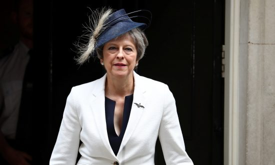 Britain's Prime Minister Theresa May leaves Downing Street in London, July 10, 2018. (Reuters/Hannah McKay)