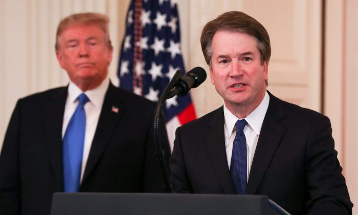 Supreme Court nominee Judge Brett Kavanaugh speaks while President Donald Trump looks on, in the White House in Washington on July 9, 2018 (Samira Bouaou/The Epoch Times)