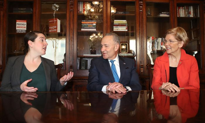 Senate Minority Leader Chuck Schumer (D-N.Y.)(C) and Sen Elizabeth Warren (D-Mass.)(R), meet with Leandra English (L), named as acting director of the Consumer Financial Protection Bureau by outgoing director Richard Cordray, at the U.S. Capitol on Nov. 27, 2017 in Washington.  (Mark Wilson/Getty Images)