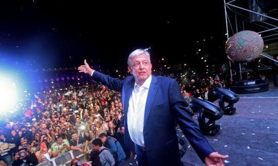 """Newly elected Mexico's President Andrés Manuel López Obrador, running for the """"Juntos haremos historia"""" party, cheers his supporters at the Zocalo Square after winning the general election, in Mexico City, Mexico on July 1, 2018. (PEDRO PARDO/AFP/Getty Images)"""
