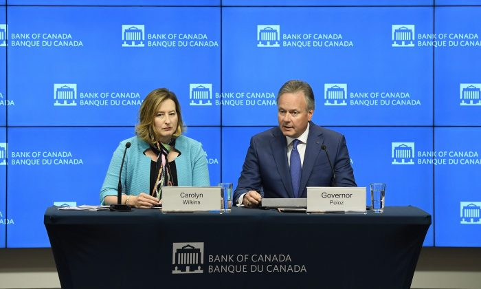 Governor of theBankofCanadaStephen Poloz speaks as Senior Deputy Governor Carolyn Wilkins looks on after the central bank raised its overnight rate target to 1.5 percent in Ottawa on July 11, 2018. (The Canadian Press/Justin Tang)