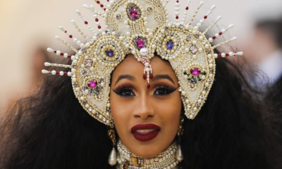 """Rapper Cardi B arrives at the Metropolitan Museum of Art Costume Institute Gala to celebrate the opening of """"Heavenly Bodies: Fashion and the Catholic Imagination"""" in the Manhattan borough of New York on May 7, 2018. (REUTERS/Carlo Allegri/File Photo)"""