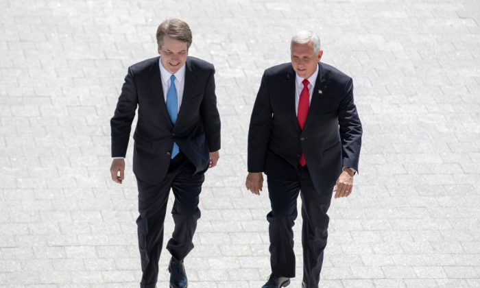 Vice President Mike Pence, right, and Supreme Court nominee Brett Kavanaugh arrive at the U.S. Capitol on July 10, 2018. (Alex Edelman/Getty Images)