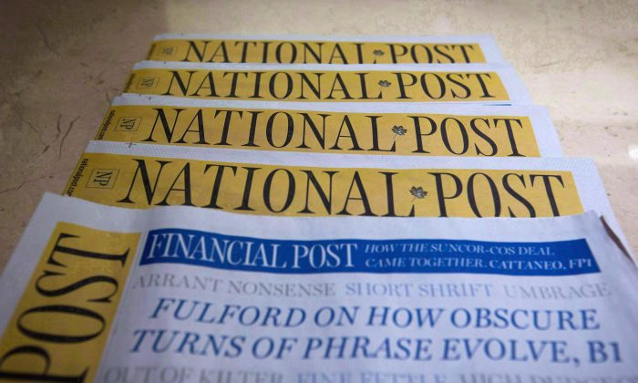 Copies of the Postmedia-owned National Post are displayed at a hotel in Burnaby, B.C. (The Canadian Press/Darryl Dyck)