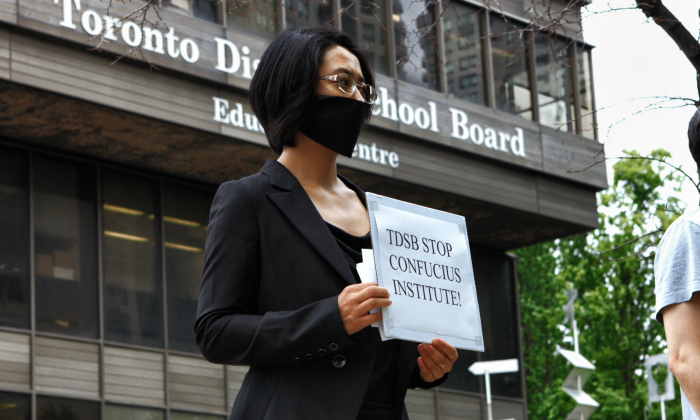 Former Confucius Institute teacher, Sonia Zhao demonstrates against the Confucius Institutes outside the Toronto District School Board. (Mark Media)