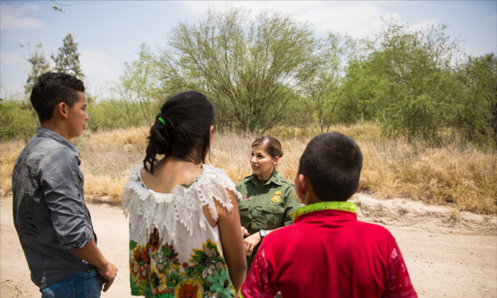 Border Patrol agent Marlene Castro speaks to a group of unaccompanied minors who just crossed illegally from Mexico into the United States in Hidalgo County, Texas, on May 26, 2017. (Benjamin Chasteen/The Epoch Times)