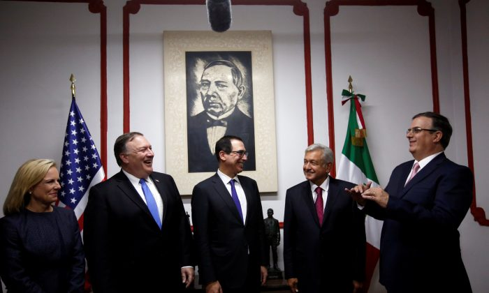 U.S. Secretary of State Mike Pompeo, Mexico's president-elect Andres Manuel Lopez Obrador, U.S. Homeland Security Secretary Kirstjen Nielsen, U.S. Secretary of the Treasury Steven Mnuchin and Marcelo Ebrard, designated foreign minister of Mexico's president-elect Andres Manuel Lopez Obrador pose for a picture before a meeting in Mexico City, Mexico on July 13, 2018. (REUTERS/Carlos Jasso)
