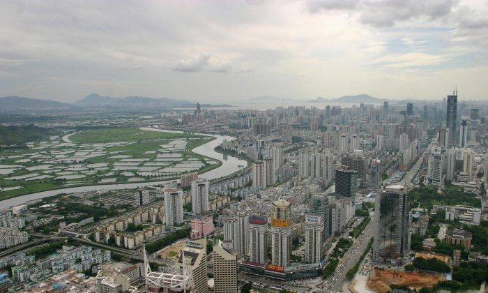 The skyline of Shenzhen City, Guangdong Province, China on August 18, 2004. A hotel in Shenzhen recently imposed a 25 percent surcharge on American guests staying there. (Samantha Sin/AFP/Getty Images)