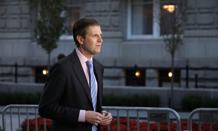 Eric Trump, son of Donald Trump, does a television interview before the ribbon cutting ceremony during the grand opening of the new Trump International Hotel in Washington on Oct. 26, 2016. (Chip Somodevilla/Getty Images)