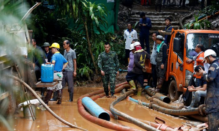 Soldiers and rescue workers near Tham Luang cave complex, as an ongoing search for members of an under-16 soccer team and their coach continues, in the northern province of Chiang Rai, Thailand, July 2, 2018. (Soe Zeya Tun/Reuters)