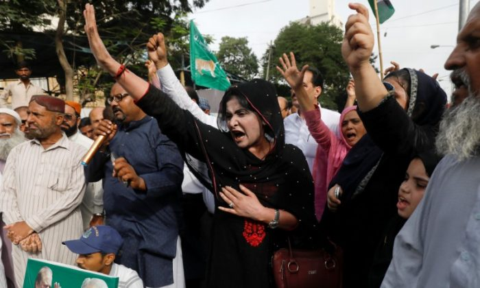 Supporters of the Pakistan Muslim League - Nawaz (PML-N) chant slogans against the arrest of their activists in Lahore who were on their way to welcome ousted Prime Minister Nawaz Sharif and his daughter Maryam, during a protest in Karachi, Pakistan July 13, 2018. (Akhtar Soomro/Reuters)