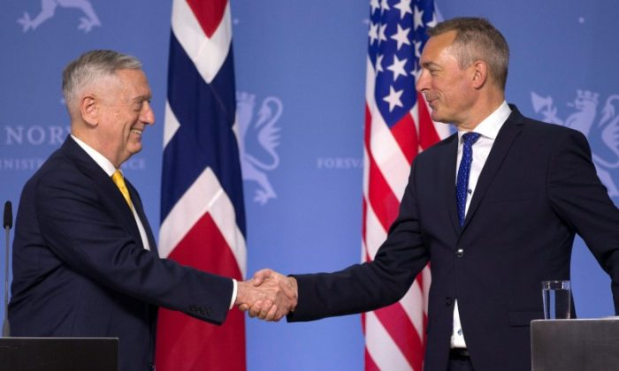 US Secretary of Defence James Mattis shakes hands with Norwegian Minister of Defense Frank Bakke-Jensen during a press conference at the Ministry of Defence in Olso, Norway on July 14, 2018. (NTB Scanpix/Trond Reidar Teigen/via Reuters)