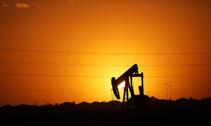 A pumpjack sits on the outskirts of town at dawn in the Permian Basin oil field in the oil town of Midland, Texas, on Jan. 21, 2016. (Spencer Platt/Getty Images)