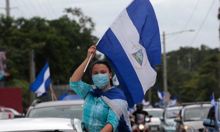 An anti-government protester takes part in a caravan of car and motorcycles to demand an end to violence in Ticuantepe, Nicaragua July 15, 2018.(Reuters/Oswaldo Rivas)