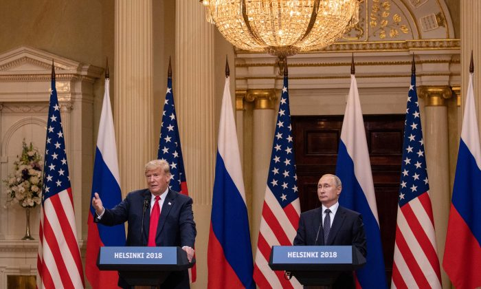 President Donald Trump and Russian President Vladimir Putin hold a joint press conference at the Presidential Palace in Helsinki, Finland, on July 16, 2018. (Samira Bouaou/The Epoch Times)