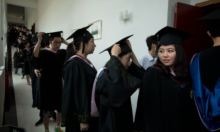 Students line up to receive their degree certificates at the Kade College Capital Normal University on the outskirts of Beijing on June 26, 2013. (Ed Jones/AFP/Getty Images)