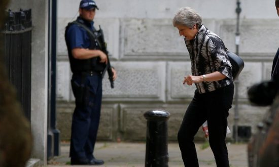 Britain's May Wins Parliament Vote After Bowing to Brexit Pressure