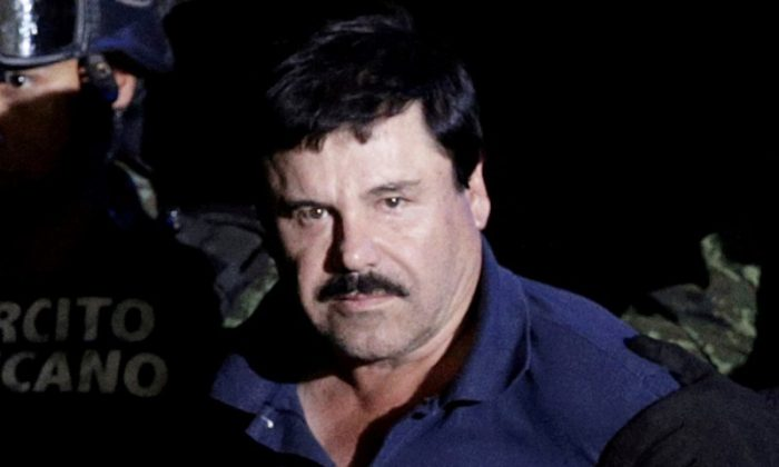 """Recaptured drug lord Joaquin """"El Chapo"""" Guzman is escorted by soldiers at the hangar belonging to the office of the Attorney General in Mexico City, Mexico Jan. 8, 2016. (REUTERS/Henry Romero/File Photo)"""