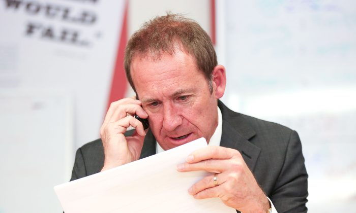 Former Labour leader (now New Zealand Justice Minister) Andrew Little makes a campaign call during a visit to Rongotai candidate Paul Eagle's phone bank on Sept. 21, 2017, in Wellington, New Zealand. (Hagen Hopkins/Getty Images)