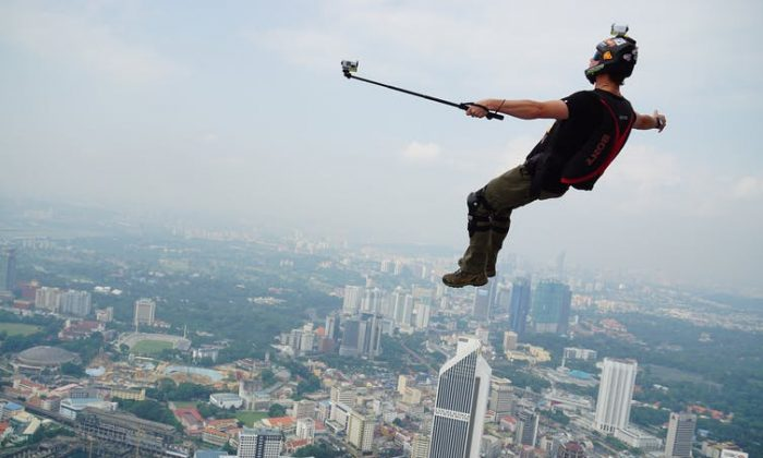 A base jumper takes a selfie over a city in this undated photograph, (shutterstock)
