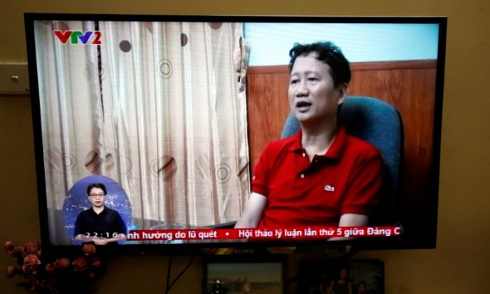 An image of Vietnamese former oil executive Trinh Xuan Thanh is seen on a TV screen on state-run television VTV, Aug. 3, 2017. (Reuters/Kham/File Photo)