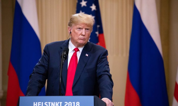 U.S. President Donald Trump and Russian President Vladimir Putin (not pictured) hold a joint press conference at the Presidential Palace in Helsinki, Finland, on July 16. (Samira Bouaou/The Epoch Times)