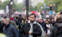 France's Macron Under Fire After Aide Caught Hitting Street Protester
