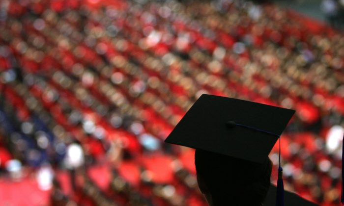 Students at a graduation ceremony at Tsinghua University in Beijing on July 18, 2007. (China Photos/Getty Images)