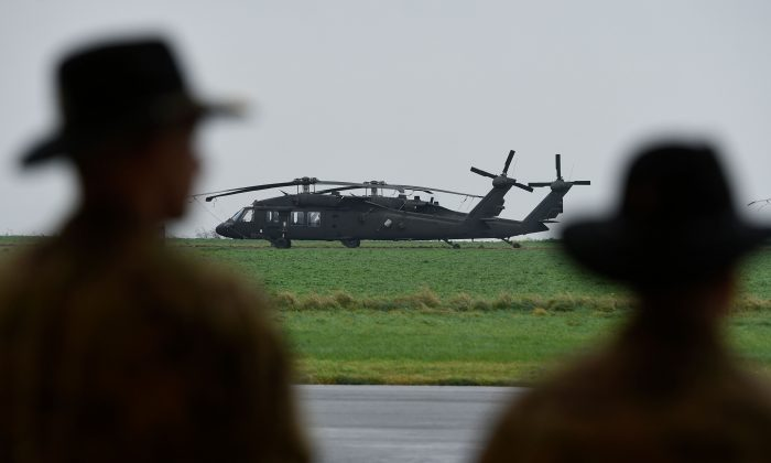 Soldiers from the US Army 1st Cavalry Brigade, 1st Cavalry Division, stand in front of UH-60 Black Hawk helicopters on the tarmac at Shape Airfield at Chievres Air Base in Belgium, on October 24, 2017. (JOHN THYS/AFP/Getty Images)