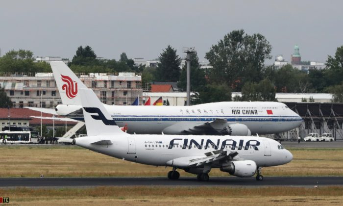 A Finnair plane passes an Air China plane at the Tegel Airport in Berlin on July 10, 2018. (Jorg Carstensen/AFP/Getty Images)