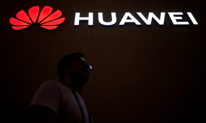 A man walks past a sign board of Huawei at the Consumer Electronics Show Asia 2018 in Shanghai, China, June 14, 2018. (Reuters/Aly Song/File Photo)