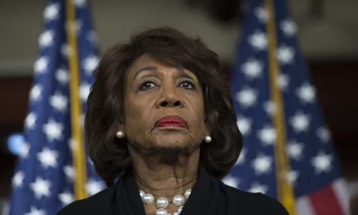 US Representative Maxine Waters (D-CA) looks on before speaking on Capitol Hill in Washington on Jan. 9, 2018. (Andrew Caballero-Reynolds/AFP/Getty Images)