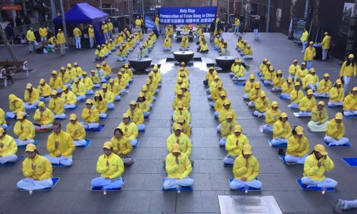 Sydney Falun Gong practitioners commemorate their brothers and sisters who have suffered or lost their lives after what is now 19 years of brutal persecution by the Chinese Communist Party on July 20, 2018. (Henry Lam)