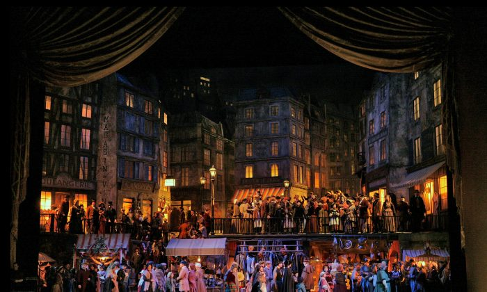 """A scene from Act 2 of Giacomo Puccini's """"La Bohème"""" playing in the fall of 2018. The production will retain Franco Zeffirelli's exquisite set.  (Ken Howard/Metropolitan Opera)"""
