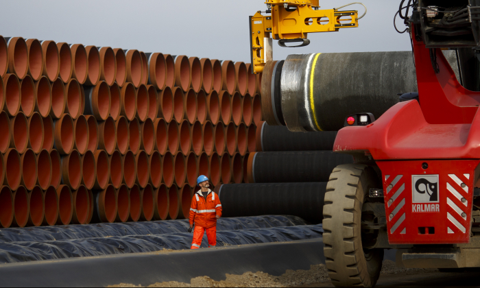 Pipes are loaded for stacking at the Nord Stream 2 facility at Mukran on Ruegen Islandon in Sassnitz, Germany, on Oct. 19, 2017. (Carsten Koall/Getty Images)