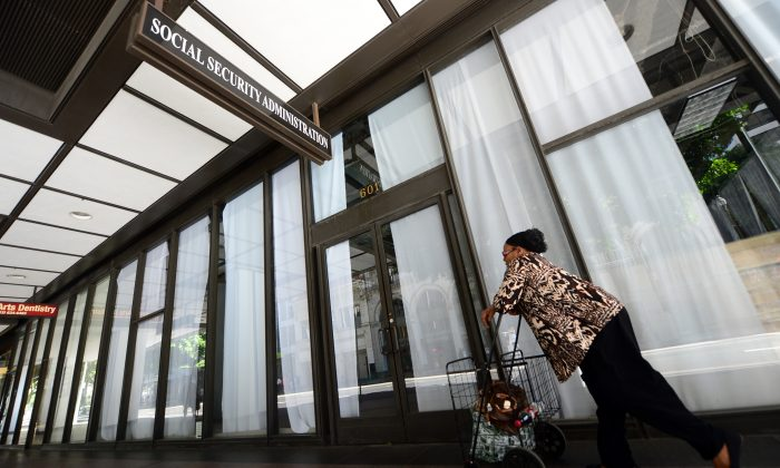 A woman walks past the Social Security Administration office in downtown Los Angeles, on Oct. 1, 2013. (FREDERIC J. BROWN/AFP/Getty Images)