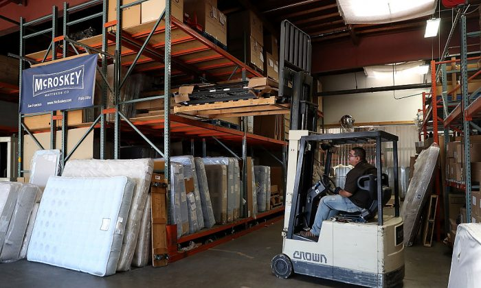 A worker operates a forklift at McRoskey Mattress Company in San Francisco, California on Aug. 9, 2016. Investment in new machinery has dropped from 8 percent of GDP in the 1970s to around 6 percent of GDP today, according to JPMorgan Chase. (Justin Sullivan/Getty Images)