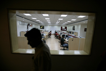 A call center in India in a file photo. (Photo by Brent Stirton/Getty Images for the GBC)