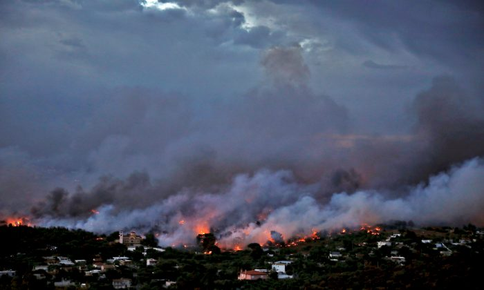 A wildfire rages in the town of Rafina, near Athens, Greece, July 23, 2018. (Reuters/Alkis Konstantinidis)