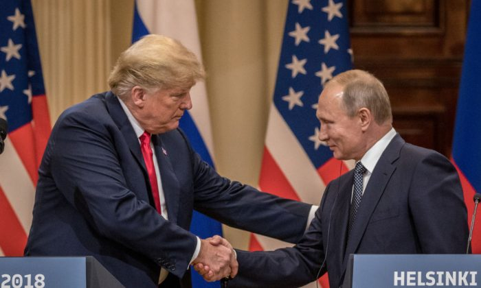 President Donald Trump (L) and Russian President Vladimir Putin shake hands during a joint press conference after their summit in Helsinki, Finland, on July 16, 2018. (Chris McGrath/Getty Images)